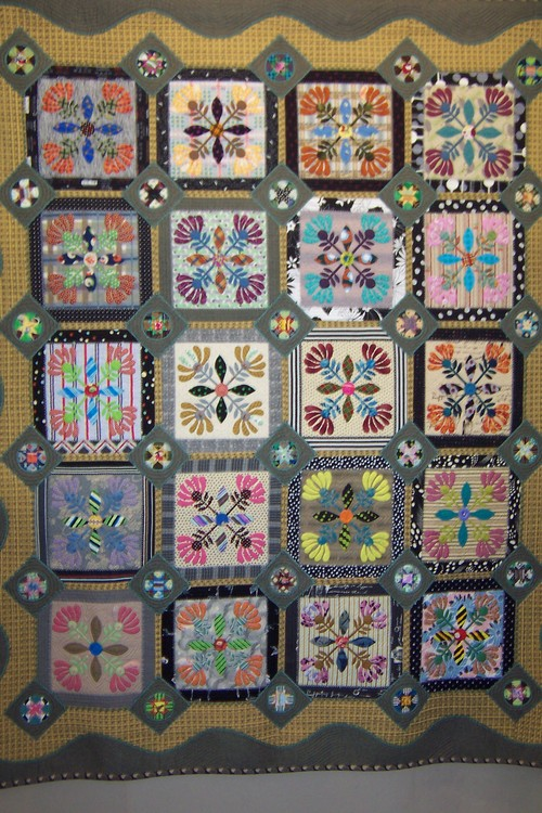 Crossed flower applique quilt
